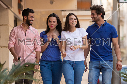 Group of young people walking in the street in korba area at day