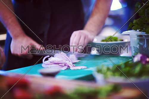 Chef hands cutting the onion with knife . Preparation for cooking. Healthy eating and lifestyle.