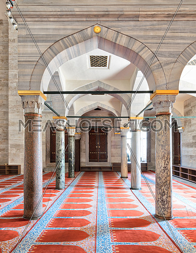 Passage in Sulaymaniye Mosque, with columns, arches and floor covered with red carpet, Istanbul, Turkey
