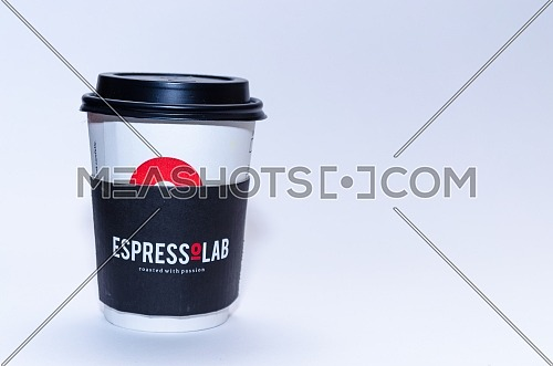 A paper cup of EspressoLab ( espresso lab ) with it's black paper cup; December 2018 in Cairo - Egypt