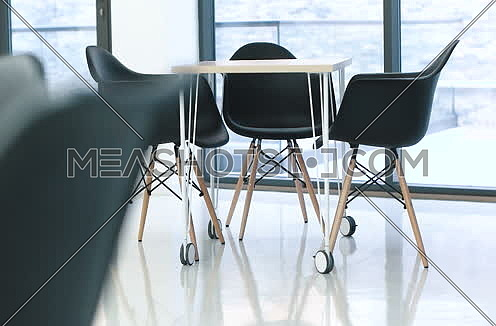 chairs and table in modern startup office