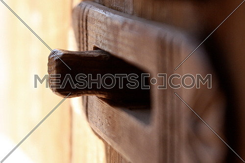A macro shot of a wooden door Handle