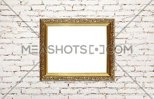 Close up antique old baroque ornate wooden classic golden painted horizontal rectangular frame for picture or photo, over grey brick wall background