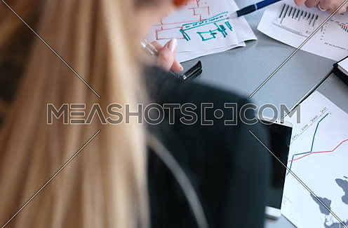 Business people preparing for meeting in bright office