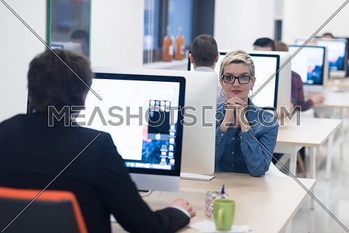 startup business, woman  working on dektop  computer at creative modern office relaxing and have fun