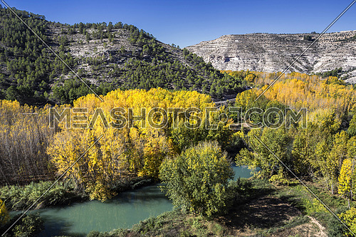 Panoramic view of the valley of the river Jucar during autumn, take in Alcala del Jucar, Albacete province, Spain