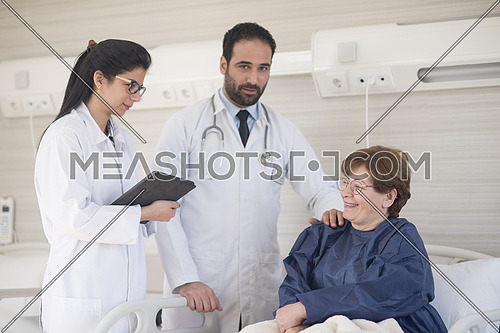 Middle eastern young doctor with nurse  and patient at hospital