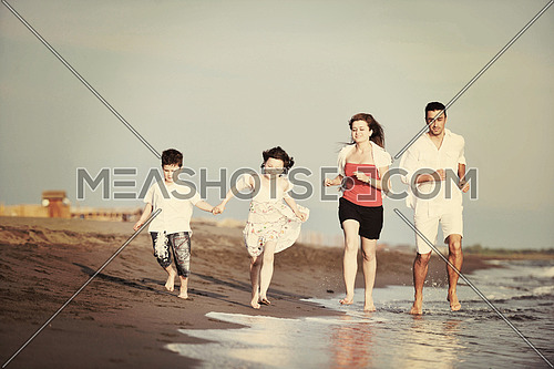happy young family have fun and live healthy lifestyle on beach