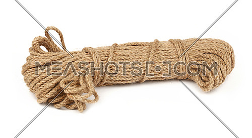 One big coil skein of natural brown twine hessian burlap jute rope isolated on white background, close up, low angle side view