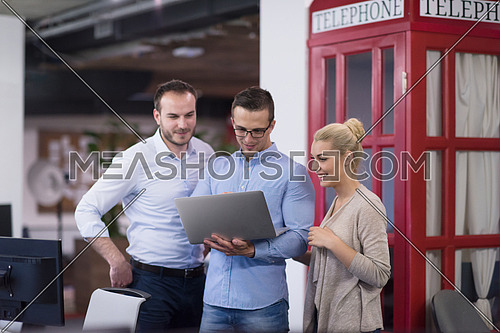 startup business people using laptop preparing for next meeting and discussing ideas in creative office