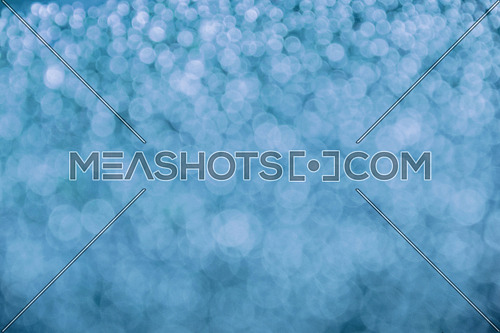 Winter blue glitter bright light christmas colors abstract blur effect festive background