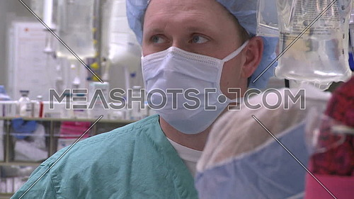 Close up for surgical technician face during surgery