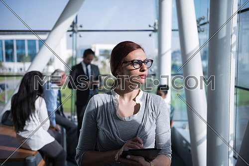portrait of young business woman at modern office interior  team have  group meeting in background