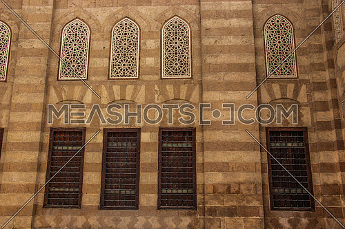 a photo for the entrance the blue mosque (sonkor) in old Islamic Cairo , Egypt showing the architecture style used , doors walls windows
