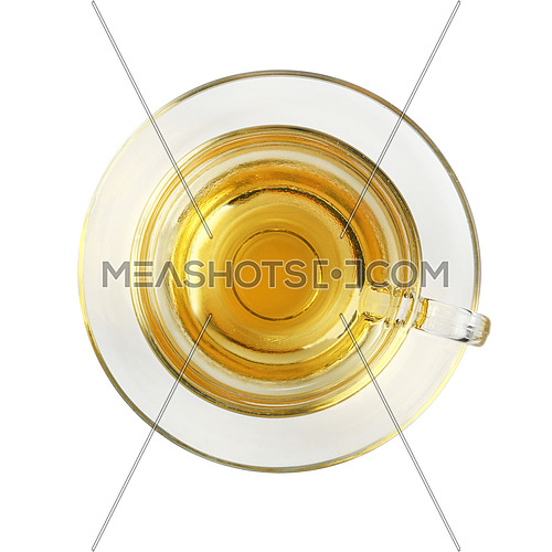 Close up one transparent glass cup of green oolong or herbal tea on saucer isolated on white background, elevated top view, directly above