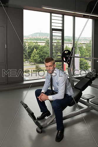 Business Man Resting After Exercise In Gym