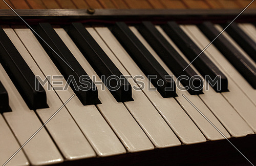 Close up old vintage piano keyboard, high angle view