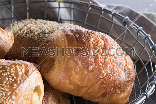 Pastry with crusted cheese on top in a basket