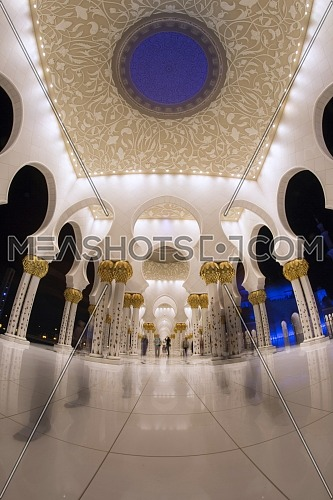 Low angel for sheikh Zayed mosque arches at night.