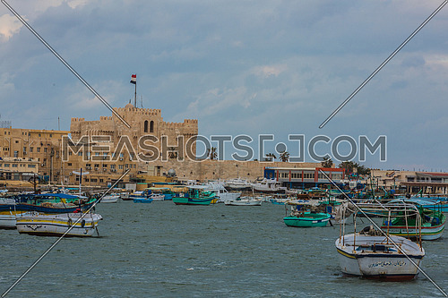 Long Shot outside Citadel of Qaitbay shows fishing boats at day