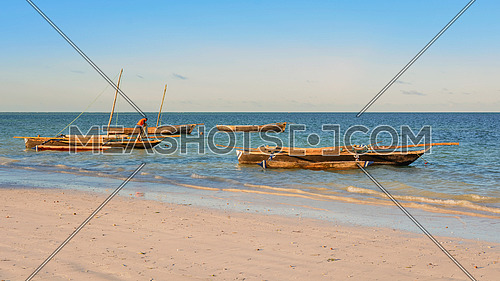 Typical wooden boats docked on the beach of Zanzibar,Tanzania republic.