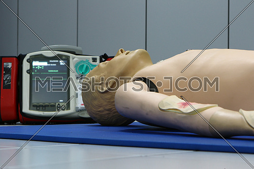 Life saving defibrillator and CPR dummy doll