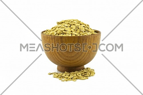 A bowl of whole oats flakes isolated on a white background