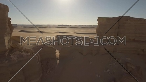 Flying over a mountain to reveal Dunes in Fayoum Desert