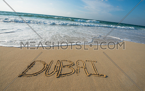 Sea shore written on the sand Dubai