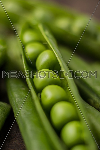 A close up on an opened RAW pea
