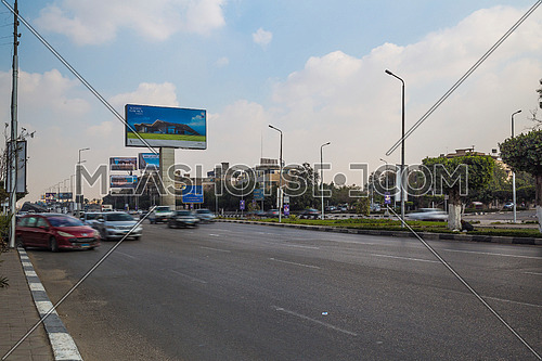 Long shot for traffic at Salah Salim Street showing AL Galaa Bridge in background