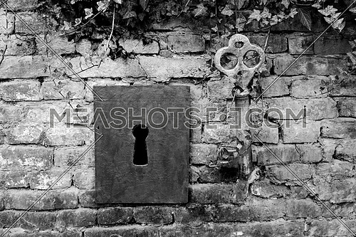 Vintage Giant Key And Keyhole On The Brick Wall
