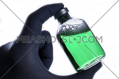 Detail of hand medical holding a vial, conceptual image