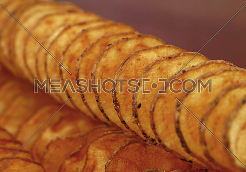 Natural round fried potato chips with skin close up, low angle view, selective focus