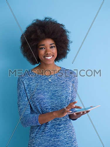 Young Happy African American Woman Using Digital Tablet  Isolated on a blue background