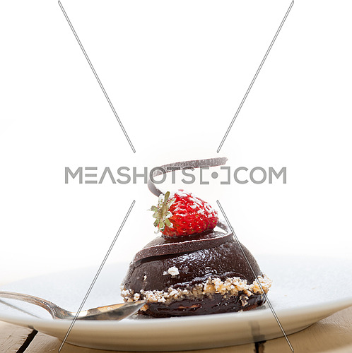 fresh chocolate strawberry mousse over white with silver spoon