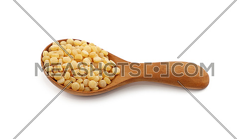Traditional ptitim pasta (Palestinei or pearl couscous) in wooden scoop isolated on white background, close up, high angle view