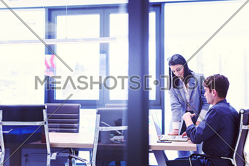 two business people using laptop  preparing for next meeting and discussing ideas