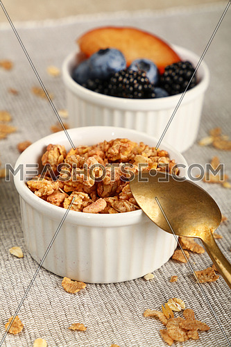 Close up portion of muesli granola breakfast with yogurt, fruits and berries, high angle view