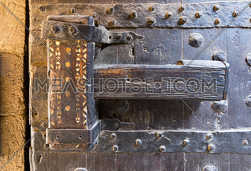 Wooden latch of the wooden ancient gate of the caravansary (Wikala) of Bazaraa, Cairo, Egypt