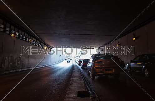 Track Left Shot for traffic from inside  Al Thawra Tunnel at Daytime