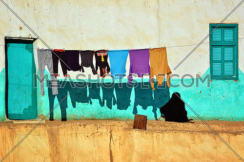 a rope used for hanging clothes to dry at the outside of a village house in Nuba, Egypt