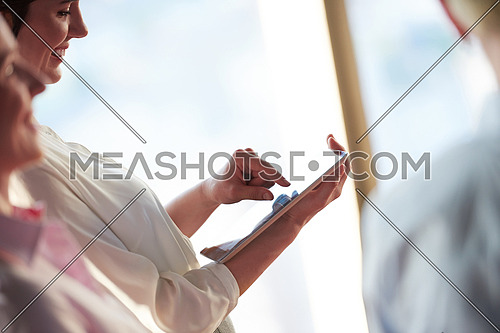 young business woman working on tablet computer at office
