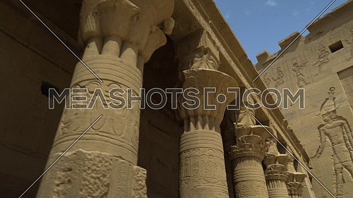 tracking in shot inside Temple of Phila showing columns, Aswan Egypt