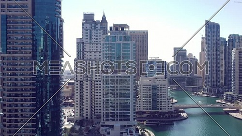 Aerial view of Dubai city. Drone fly over futuristic Dubai Marina district on beautiful day. Residential Modern skyscraper buildings