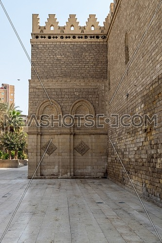 Outer wall of public historic Al Hakim Mosque known as The Enlightened Mosque, located in Moez Street, Old Cairo, Egypt
