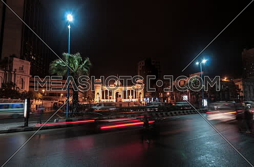 Fixed long shot for traffic towards Alexandria Naval Unknown Soldier Memorial at night