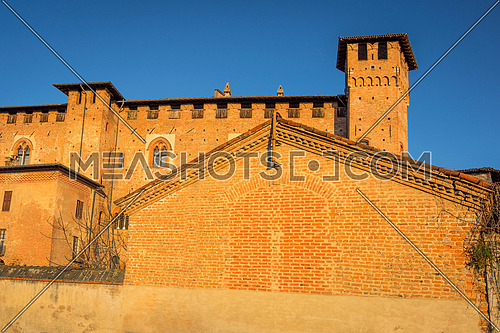 "Medieval castle ""Morando bolognini"" at sunset, built in the thirteenth century in Sant'Angelo lodigiano,Lombardy italy."