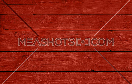 Close up background texture of red vintage weathered painted wooden planks, rustic style wall panel