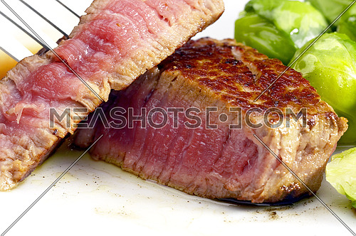 juicy filet mignon cutted on plate with brussel sprout